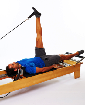 pilates reformer foot in strap for hamstrings