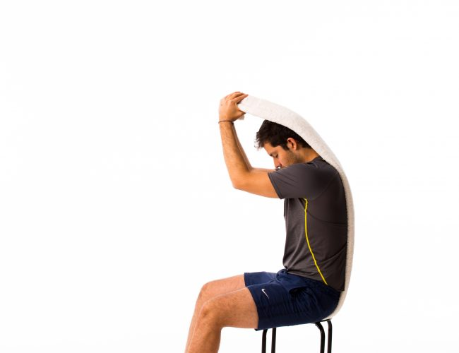 Exercises for spondylolisthesis supported towel C curve