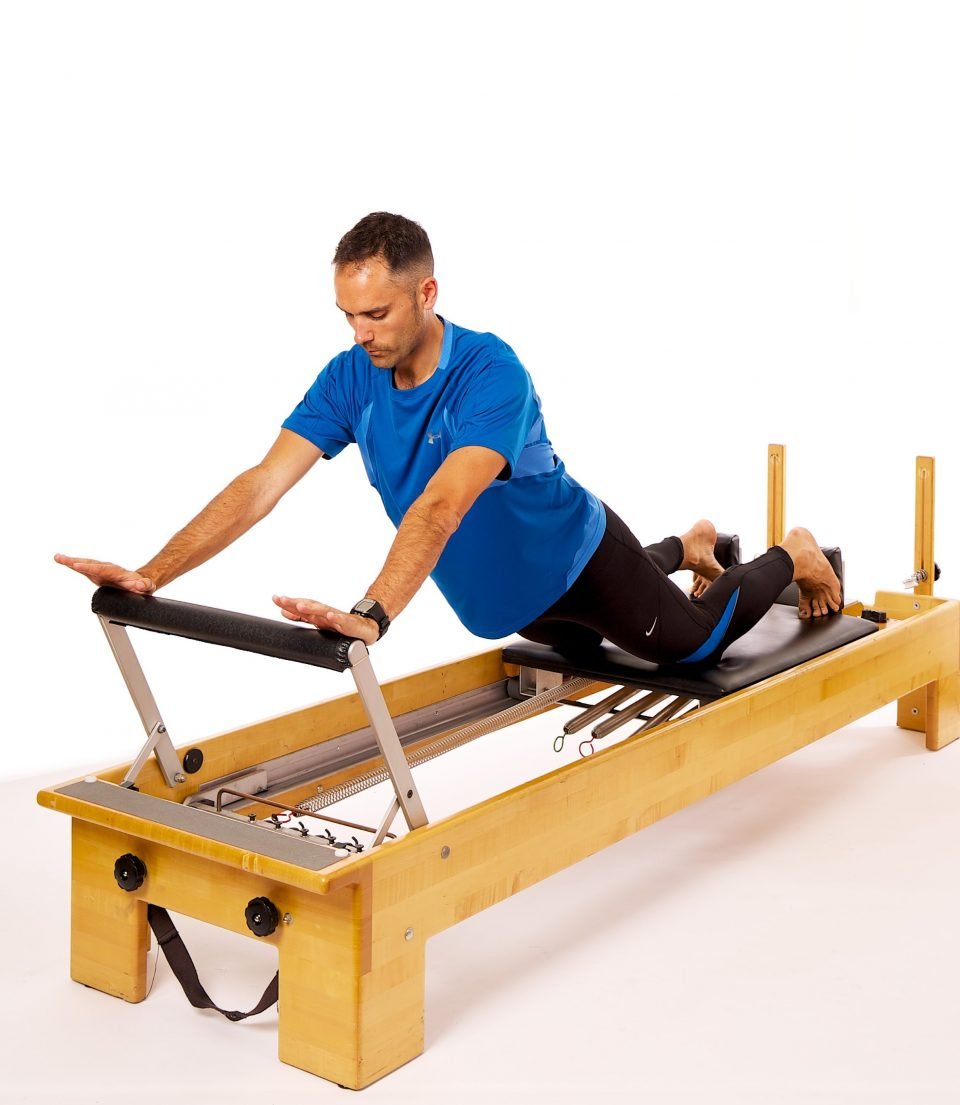 reformer down-stretch progression balance exercise