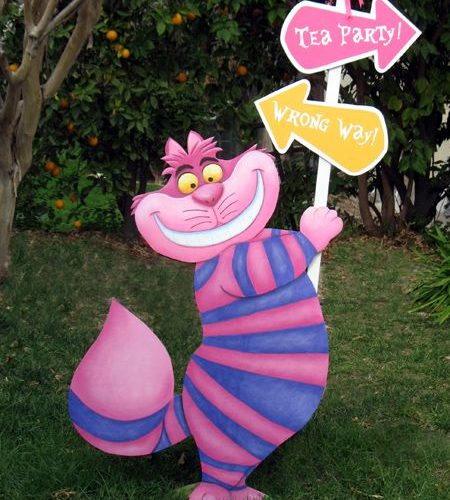 cheshire cat holding a sign